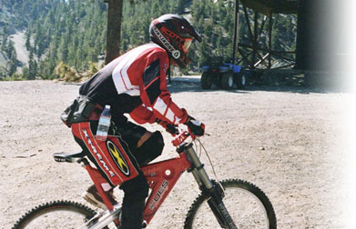 Extreme mountain biker racing along the beautiful Mt. Baldy trails.